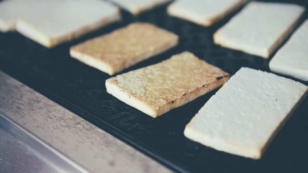 A Word On Grilling Tofu: - Grilling tofu can be tricky because tofu loves to stick to things. Make sure you oil up whatever surface you choose and cut the tofu in a way that it doesn't fall down into the grill. I used a grill pan to make it easy. Your tofu should be golden brown and crispy, so look out for that lightly-roasted marshmallow color to know it's done.