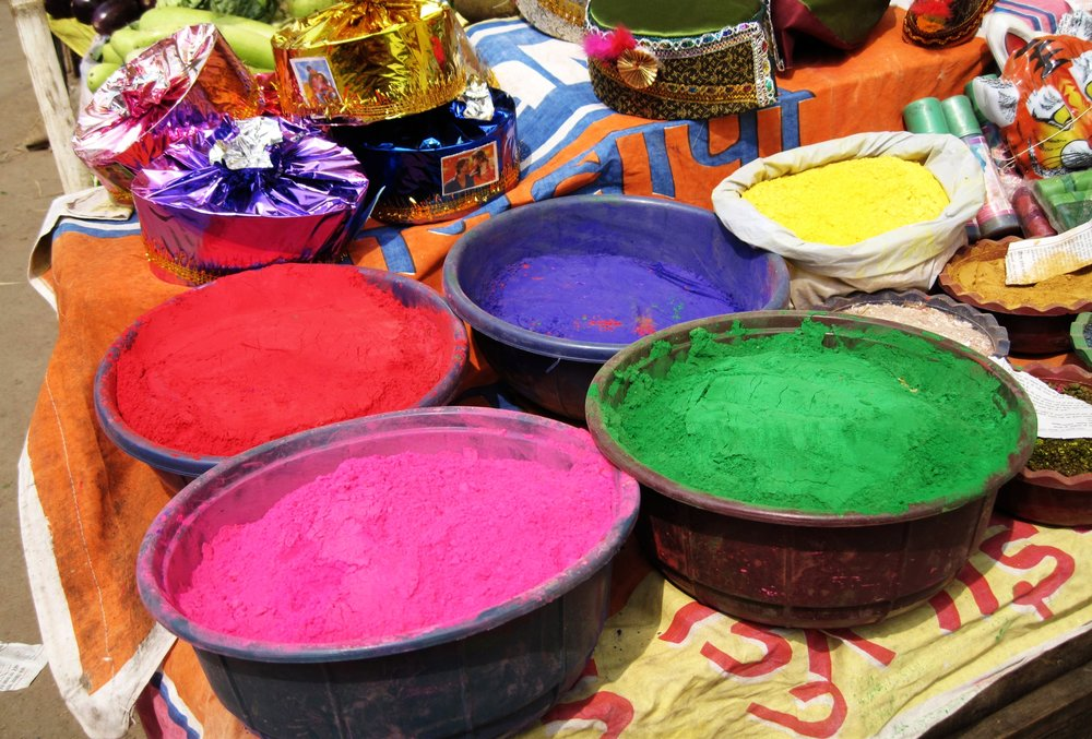 holi powders,varanasi, india - Celebrants of this popular holiday become living canvases for tenacious and toxic chemicals disguised as beautiful, bright colors.