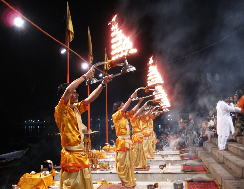 Ganga aarti,varanasi, india - These are not flaming Christmas trees. Young priests are putting the Ganges River to sleep. During this nightly ritual, called Ganga Aarti, they sing to the river and recite prayers, a nice way to drift off.