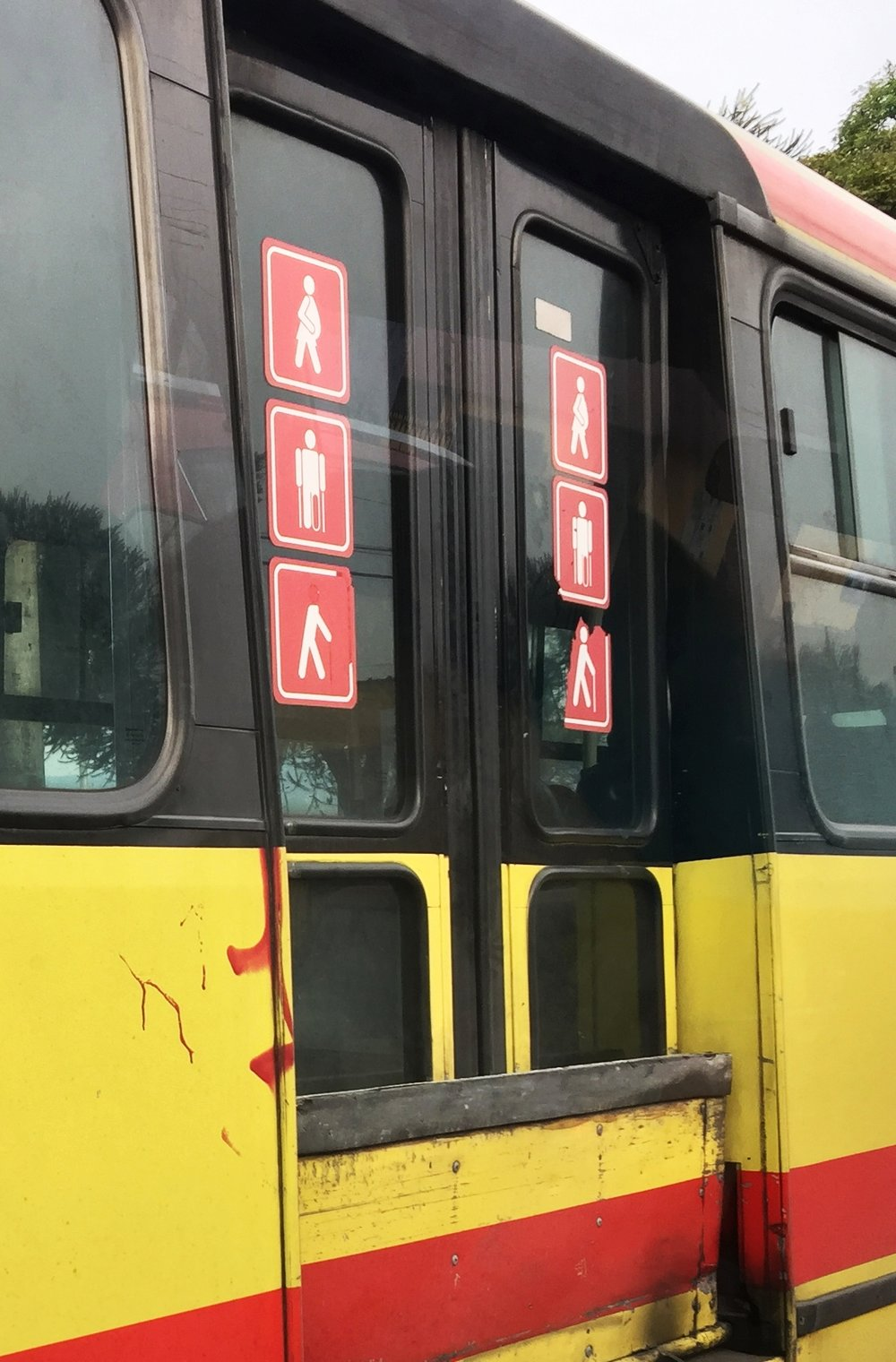 bus, quito, ecuador - Riders on this bus must relinquish their seats to pregnant women, the infirm, and to those without heads.