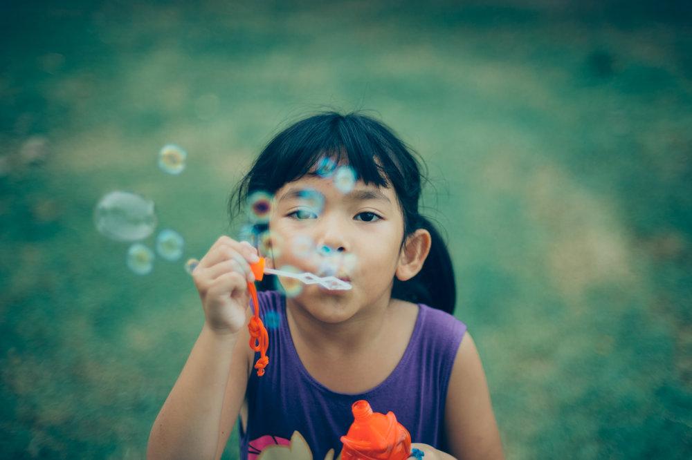 Child blowing bubbles.jpeg