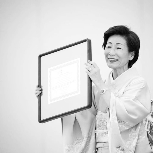 Masami Saionji - receiving an award