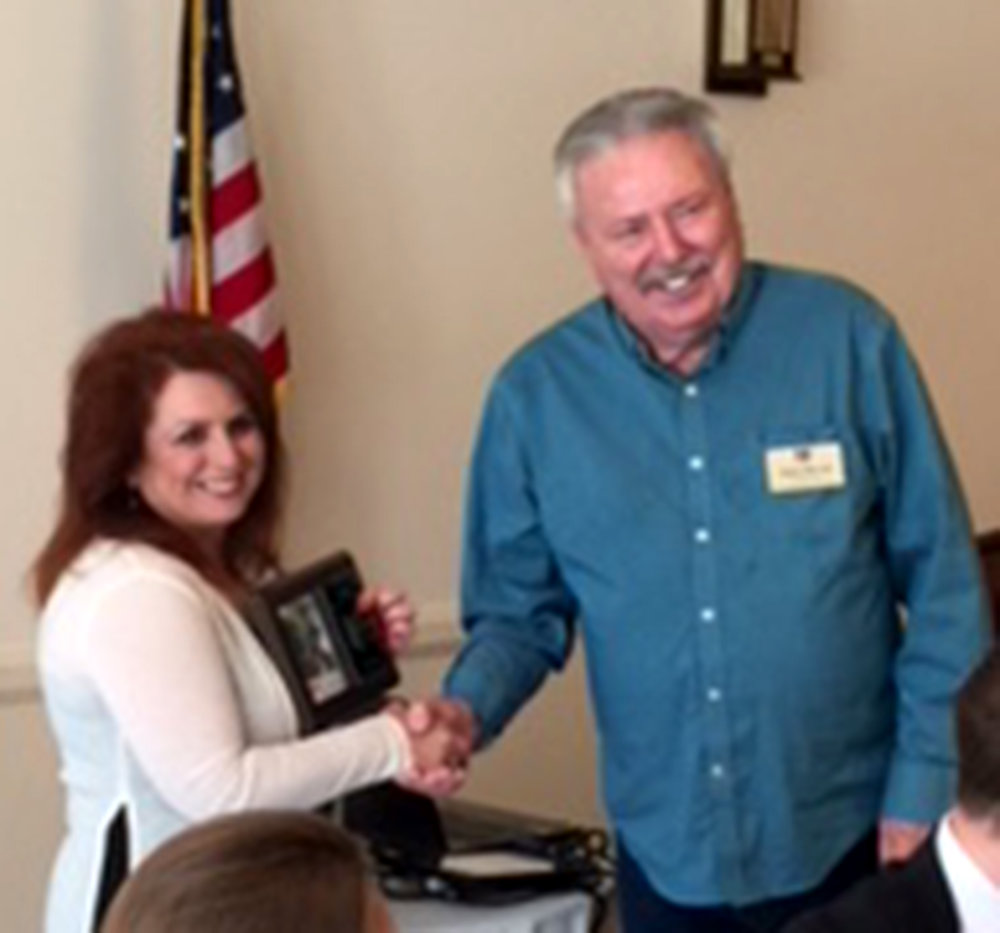 Theresa Robledo receiving Diamond Realty's Moorpark Chamber of Commerce membership plaque from Chamber Board Member Dale Parvin.