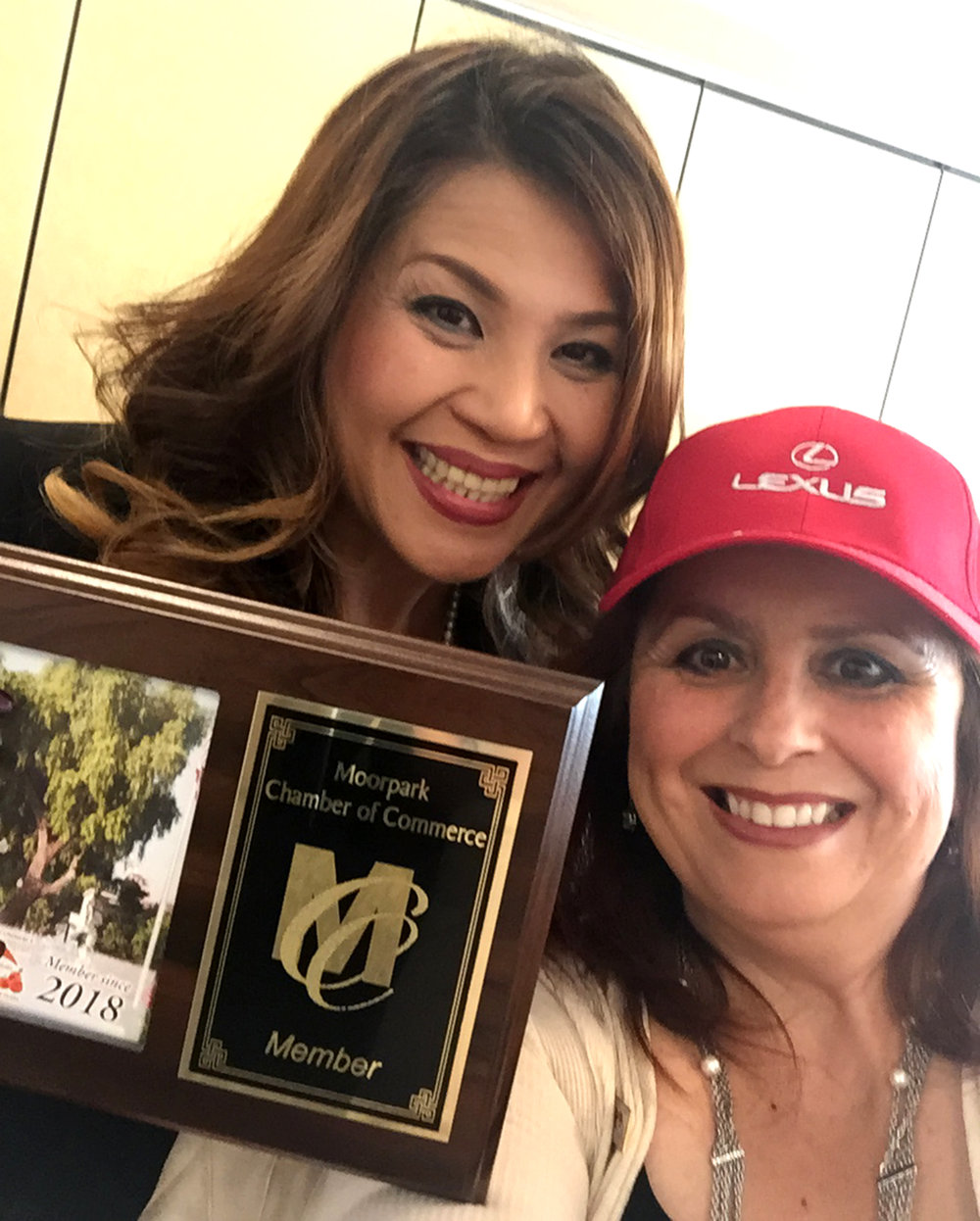 Along with becoming a Chamber Member, Theresa also won the meeting's raffle prize. Pictured left to right is Anne Marie Zielsdorf of Lexus with Theresa Robledo wearing her new Lexus cap.