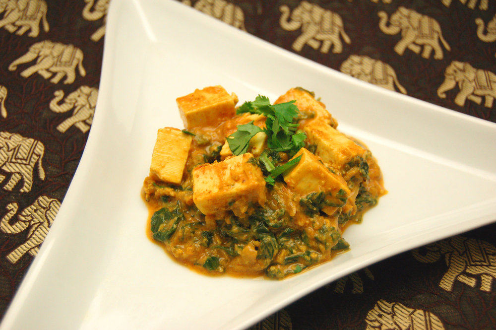 SAAG PANEER - Indian Pressed Cheese & Spinach - {Made with Arvinda's Curry Masala}Also know as Palak Paneer, this is Popeye's favourite curry. It's jam-packed with fresh, finely chopped spinach and cubes of paneer (Indian pressed cheese) enrobed in a curry sauce. This curry gets you more than your daily dose of greens. Serves well with basmati rice.