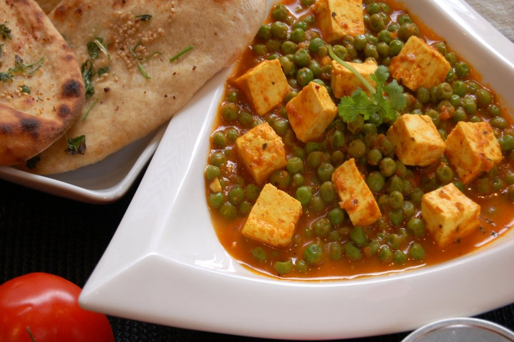 MATTAR PANEER - Indian Pressed Cheese with Peas - {Made with Arvinda's Curry Masala}Creamy, aromatic and supremely delicious, Mattar Paneer has it all! This North Indian curry of Indian pressed cheese enrobed in a beautiful tomato and cream curry sauce is satiating to the palate all in a wholesome indulgence. Serves well with rice and naan and is truly a vegetarian's heavenly pleasure!