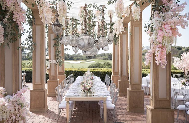 This pergola was used at a wedding held at Pelican Hill Resort, produced by A Good Affair with floral design by Nisie's Enchanted Florist. Chandeliers by Amber Event Productions.