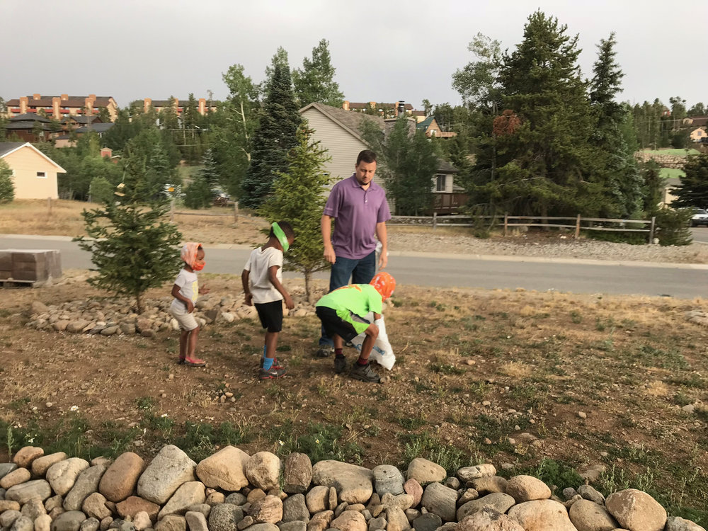 ....much to the dismay of Isaac and CJ! They quickly negotiated another $5.00 prize for themselves if they would retrieve it...so they practiced picking up a rock without touching it, and after succeeding they headed back in to pick up the real thing.