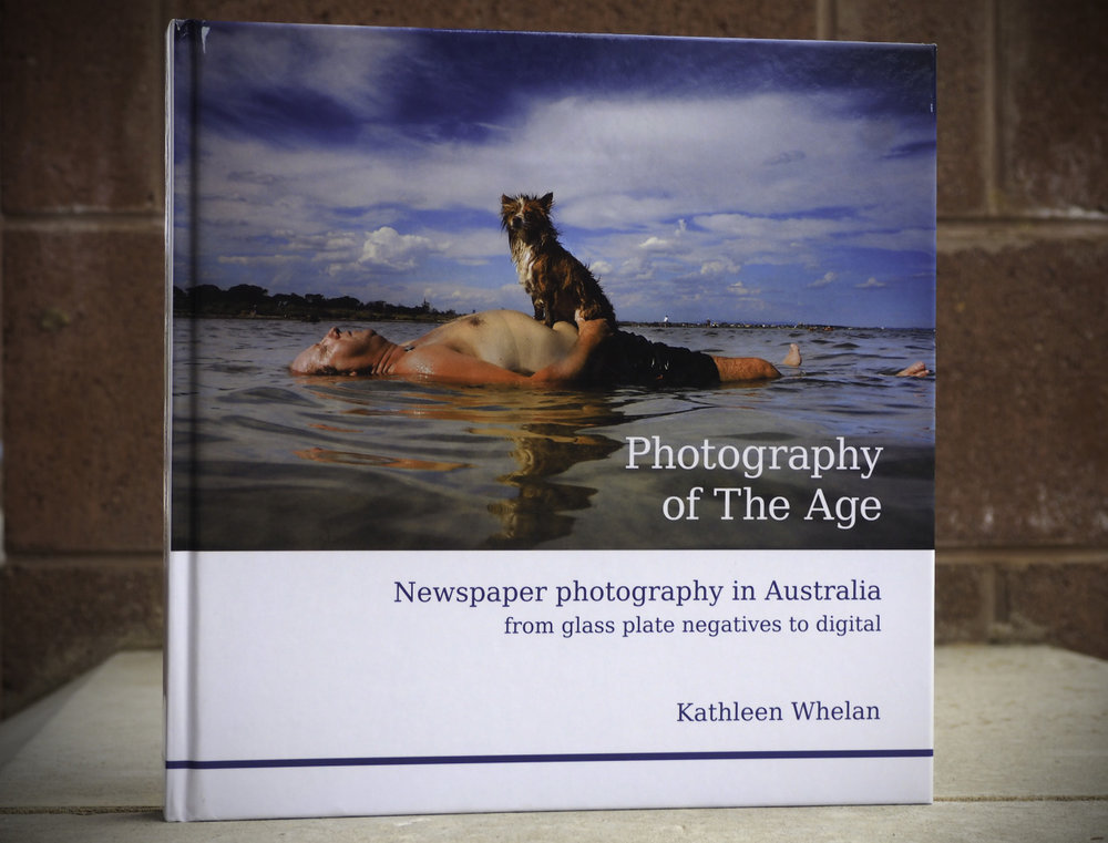 "Photography of the Age: A book review        The hardcover book is about as big, and as heavy, as a typical phonebook.      This isn't a book. It's a manual.   A blow-by-blow, day-to-day account of a day in the life of an  Age  photographer, lumped with some history, some gear talk, and a glossery.    Photography of the Age , by Kathleen Whelan, is the kind of book you need to lift with your knees. You could bludgenon an intruder with it. But what you should do with it is read it over and over until you wear the pages thin.        I was lucky to be given a signed copy, by a friend for Christmas. Thanks, @markjesser!     Photographers — you've got to get this book. Simple as that.   It encapsulates everything about working in a news photographer at  The Age  in Melbourne in chapters such as:   - The context of an image  - Legal and ethical constraints  - Use of new technologies  - The layout of the paper  - The press photographer's job   Then it profiles a whole bunch of past and present  Age  photographers, showing their work, unearthing their processes, camera settings, approach to jobs, gear, and so on.   The photography is fantastic. The content is comprehensive.   But it's very much a photographers' book. I showed mine to several non-newspaper-reading people that didn't really appreciate photography. They just shrugged and said ""it's okay"". So, I doubt the book will inspire people to pick up photography.   But — If you are a photographer, I guarantee it will inspire you to make better pictures.   This really is a look inside an organisation that affords its photographers two of the rarest things in the industry: Some time and resources. The pixels contained in this page a compelling proof that time + resources + highly-trained, creative photographers = iconic, amazing results.   But — and this is possibly my biggest gripe with the book — it's written in a pretty melancholy tone.   The blurb on the back opens with: ""Are newspapers dead?"" and finishes with ""Kathleen Whelan has recorded for posterity the Golden Age of Newspaper Photography … an age we may never see the likes of again"".   Fills your heart with joy, doesn't it? And you haven't even had a chance to open the book yet.   But photographers, don't be put off by this. Keep reading and you'll find a treasure trove of resources, learning and facinating stories.   It's a great book. Get it. Read it. Learn from it. Then, like the photographers of  The Age , go work your butt off and produce your own body of awesome images.        A photographer's profile in the book.          A spread of images.      The easiest way to buy it is to Google the title and author's name.    Ben"