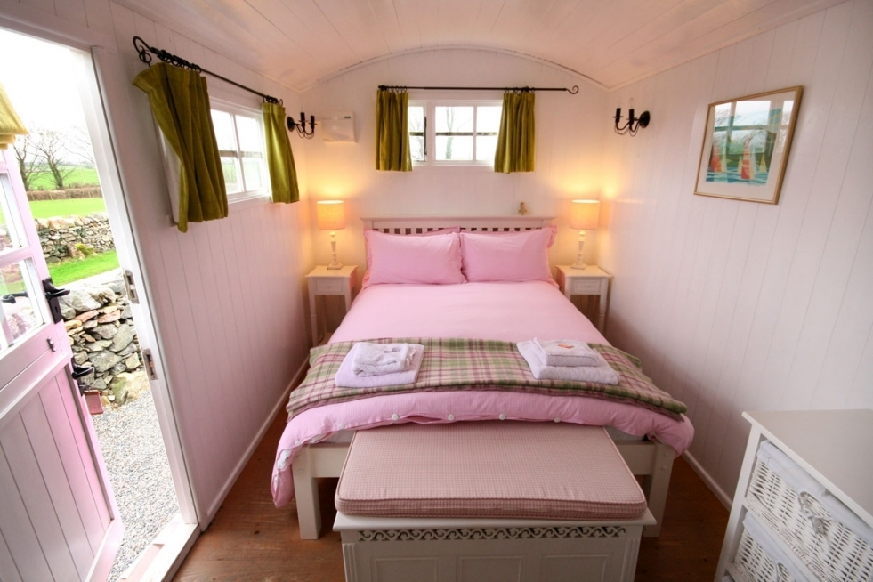 The Pink Hut - Wonderfully quirky but without compromising on comfort. Our bespoke shepherd's hut combines luxurious glamping and spectacular mountain views. Complete with wood-burning stove and en-suite shower room, and all painted in a very understated colour!En-suite shower room.
