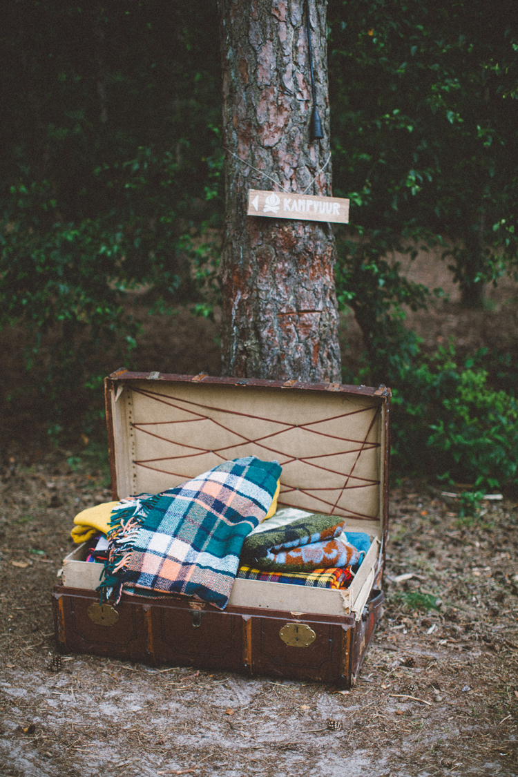 bohemian wedding in the woods | campfire decoration, vintage blankets | photography by 88forever | Inspire Styling Weddings