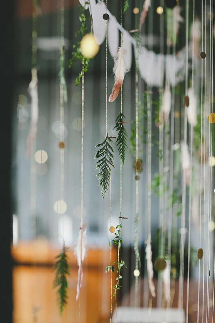 leaf, gold disc, and feather backdrop, photo by Shari + Mike Photographers