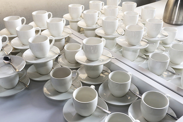 Pure white cups and saucers in rows