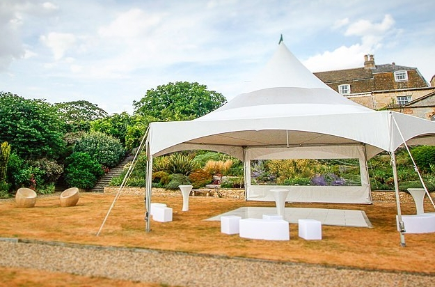 Single Hex marquee with single window wall as a windbreak. Chic LED furniture looks good for daytime and nighttime partying