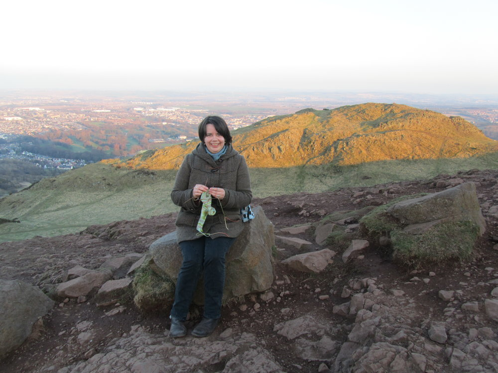 If not tech editing, probability is high that you'd find me knitting, here socks on Arthur's Seat in Edinburgh, Scotland.
