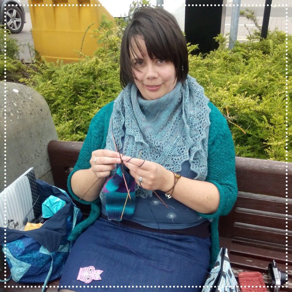 """Frauke knitting socks in Dundee, Scotland. Note the """"I'm SHERlocked"""" bag ;-)"""