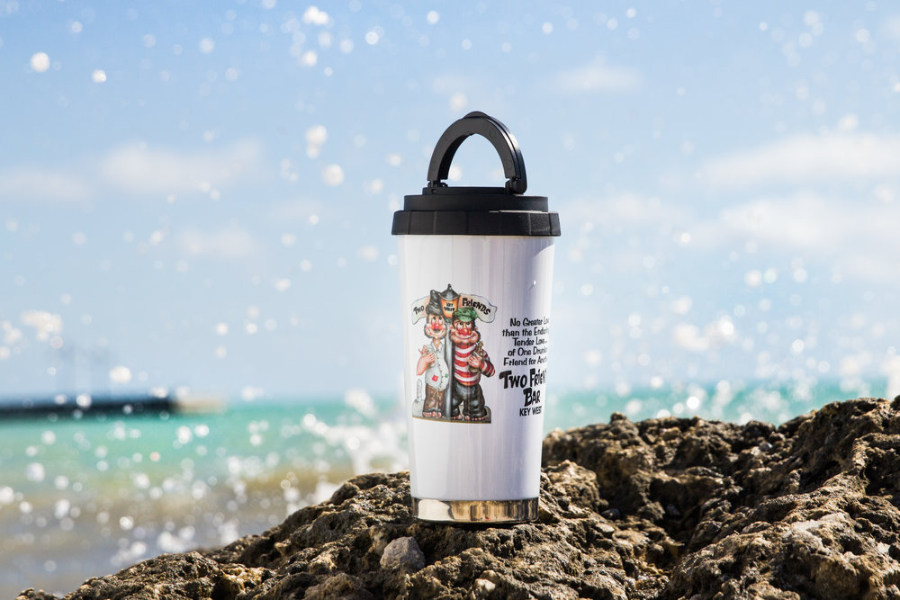 Environmental Product Photography Thermos on rocks with wave splashing behind