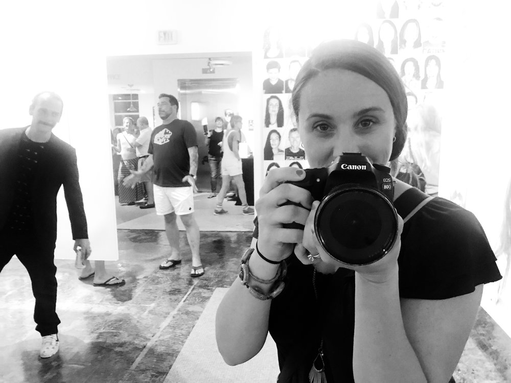 tom flip photo-bombing during his gallery opening at the studios of key west