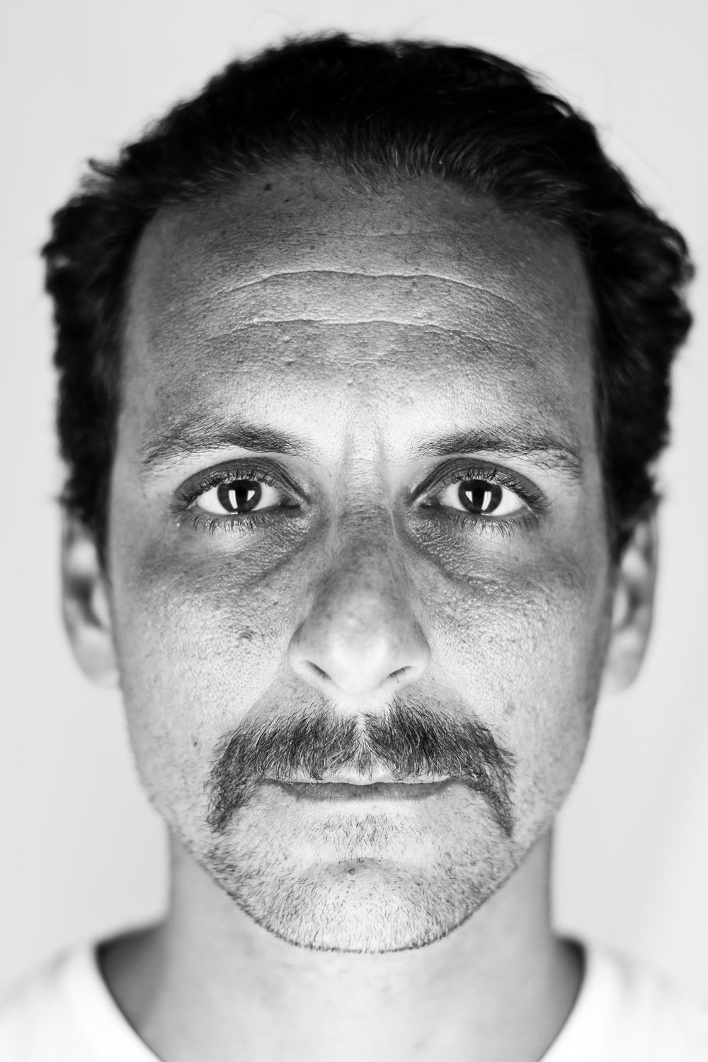 THOMAS FILIPKOWSKI, OR TOM FLIP AS HE IS KNOWN LOCALLY, CAME TO KEY WEST FROM NEW JERSEY ABOUT 15 YEARS AGO, AND BUILT HIS PHOTOGRAPHY BUSINESSES WITH AN ARTISTIC BLACK AND WHITE STYLE AND A GIFT FOR CONNECTING WITH PEOPLE THROUGH PORTRAITURE. PHOTO COPYRIGHT © TOM FLIP