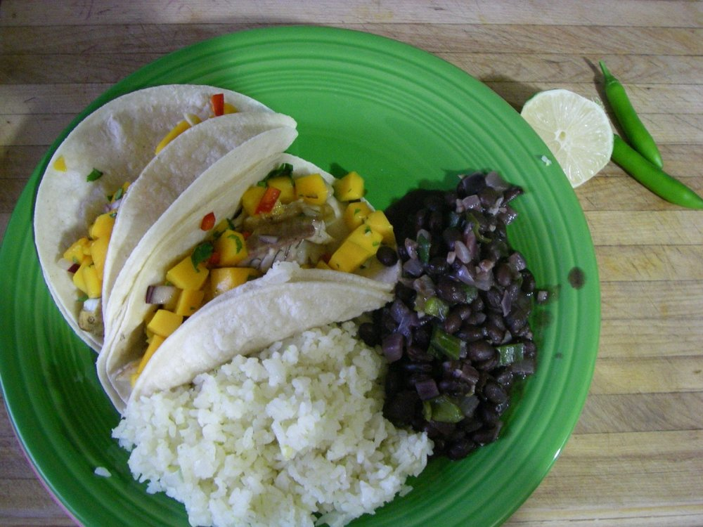 Marinated grilled Sacramento perch fillets make great fish tacos with mango salsa.