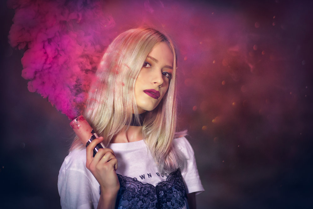 blonde girl holding pink smoke grenade in the forest Crina Popescu fotograf Universitate Bucuresti.jpg