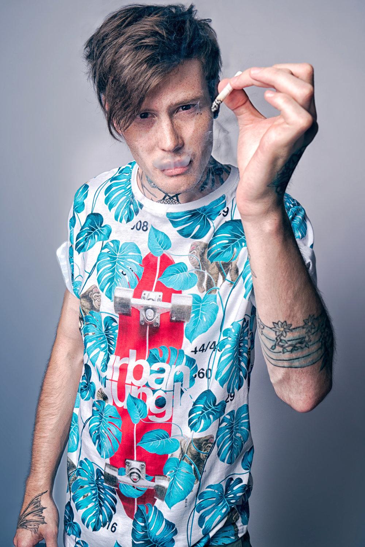 tattoo guy in colourful shirt smoking ciggar studio clar visator crina popescu fotografie si videografie bucuresti.jpg