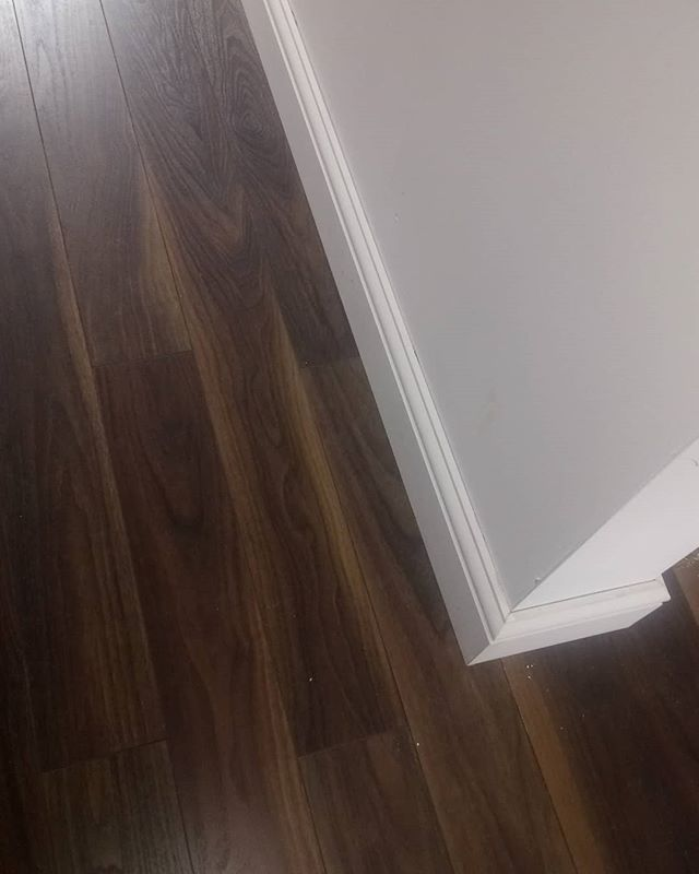 Walnut laminate flooring, a great contrast to the white finish skirting and walls. #interiordesign #hampshirehomes #carpentry #woodfloors