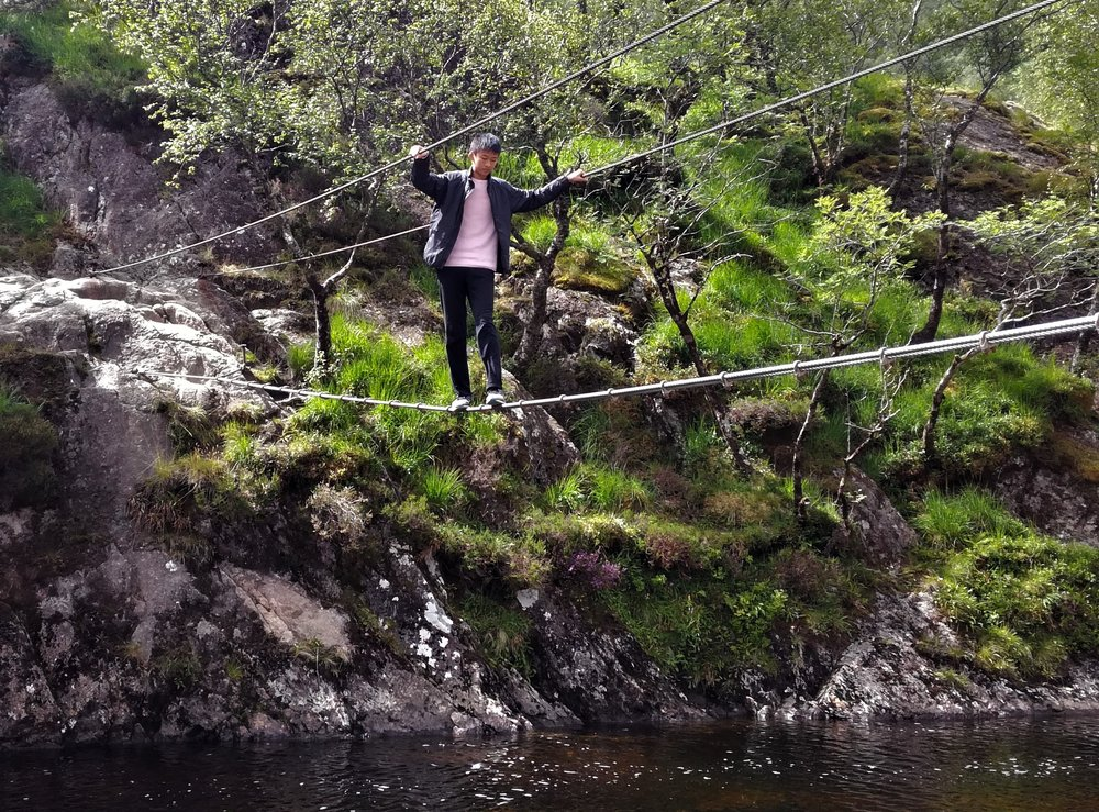 Christopher ventures along the cable bridge up Glen Nevis - one of the stop off walks on the return leg.