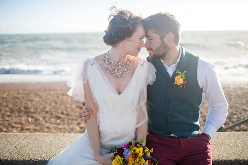 Brighton Beach - Images: Binky Nixon & Sally Ford at Binky Nixon PhotographyStylist & Co-ordinator: Erica from Mr & Mrs UniqueHair & Make-up: The Beauty ArtistVenue : Beach Hut - Vintage EventsChampagne Cocktails & Raw Chocolate Hearts: Wedding YurtsCanapes: Social PantryFlowers: Fearless FloralsFaux Fur Coat: Jolly Brown VintageDresses: Wilden BrideJewellery: Isobel Hind Couture - Deco Collection
