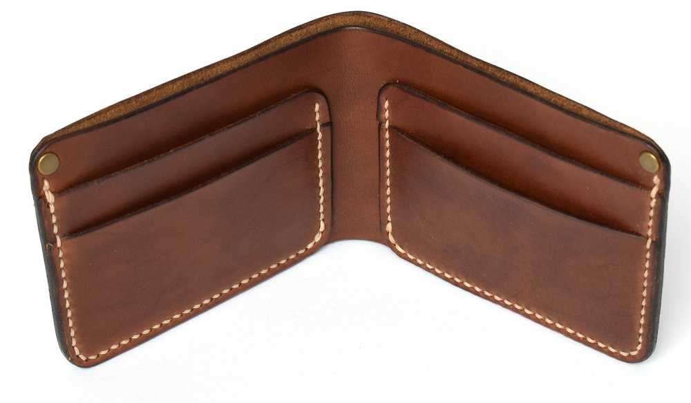 Saddle stitched by hand with super thick waxed thread and supported with brass rivets on two corners ensures the wallet will last for generations. - Shown here in Dark Brown