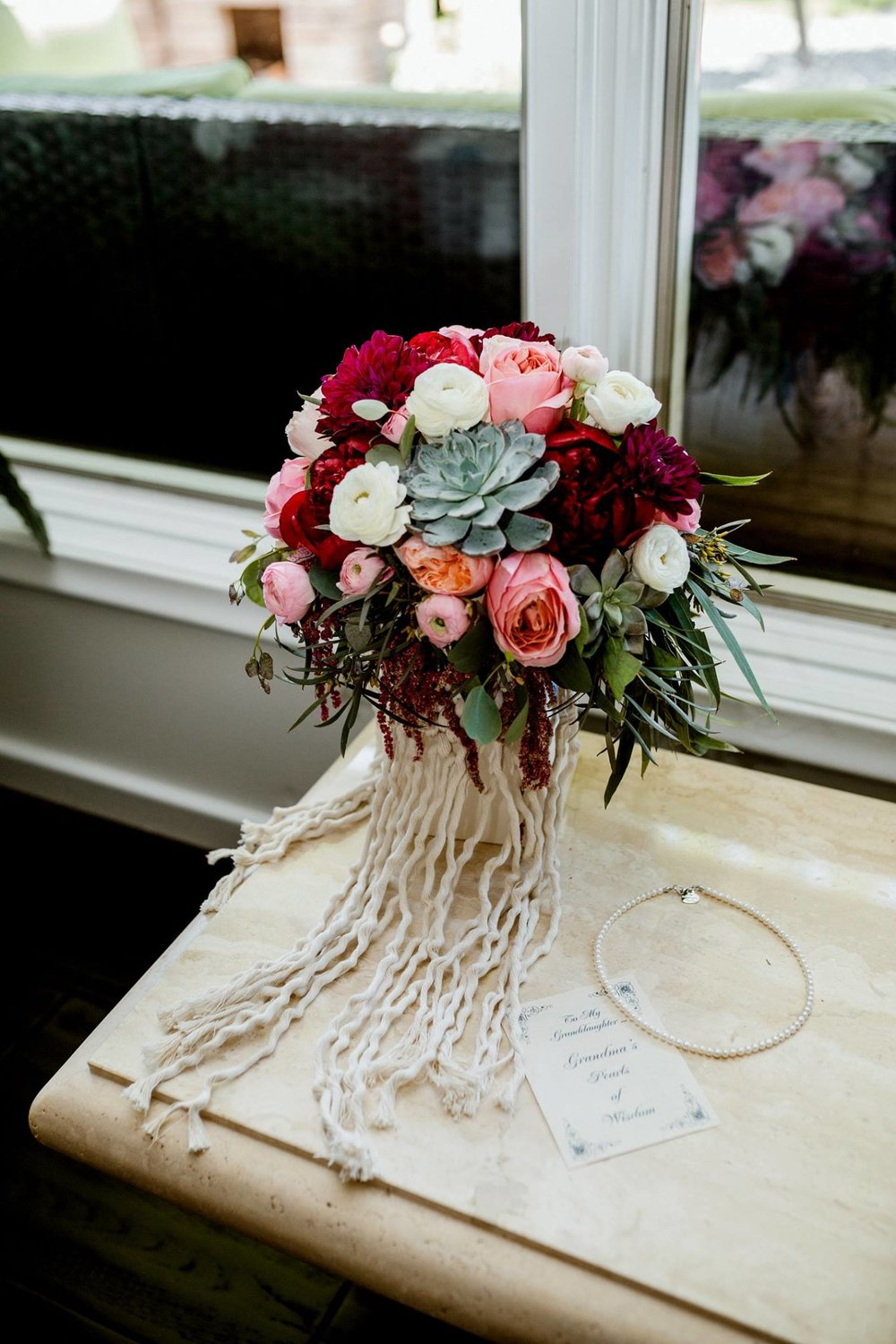 bouquet wrap by the green house. flowers by blooms and bouquets.