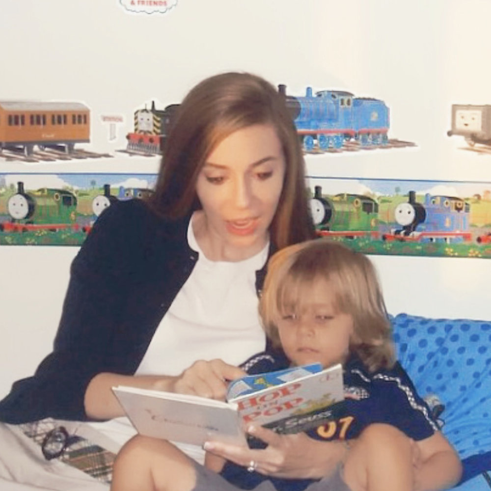 Michelle reading to her nephew