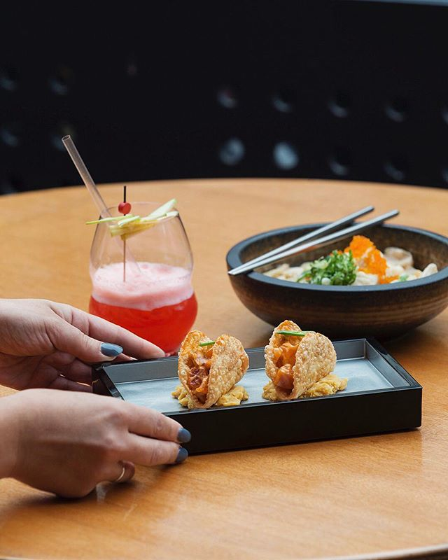 Made from deep-fried gyoza skins, our spiced sashimi tacos are a big hit with fusion fanatics. Pair yours with a Hello Kitty sour tonight from 5pm. #yokochomelbourne 📷 @ nhbpro
