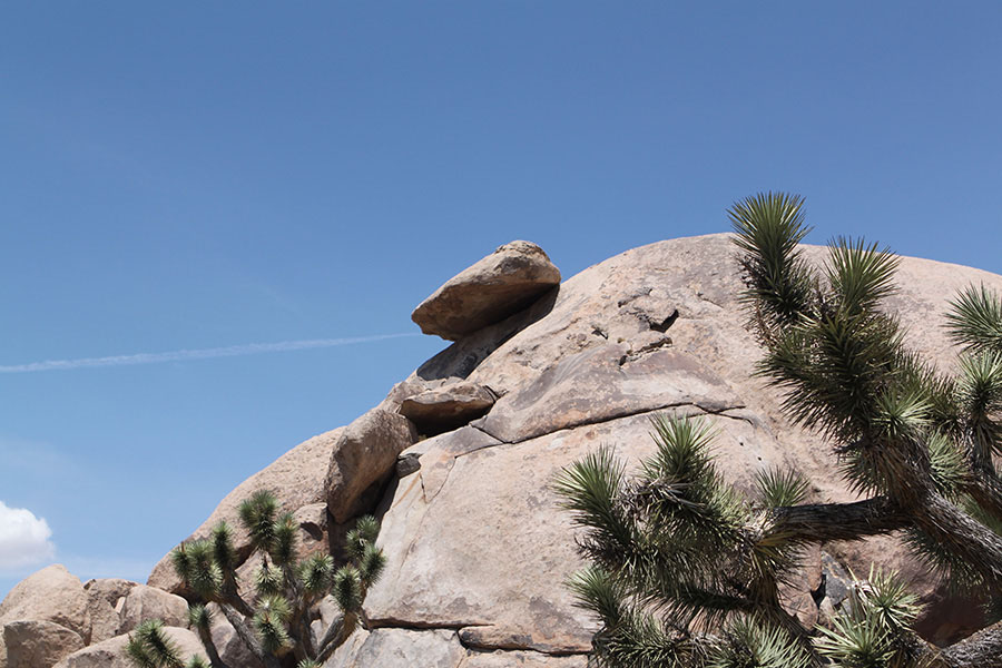 A big Boulder dangerously hanging by thread... it seems.