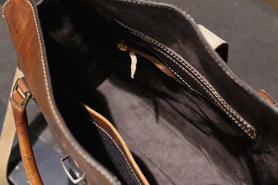 Interior: Standard.  Zipper Pocket & Kangaroo Pocket on opposite sides.
