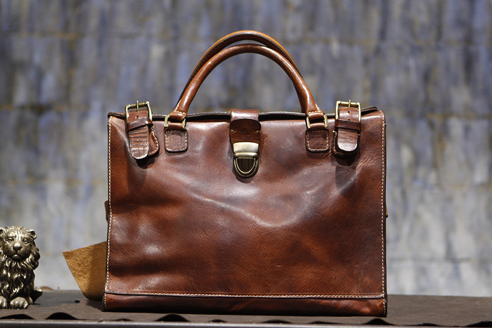 Bond Briefcase in English Tan. 3 years old.
