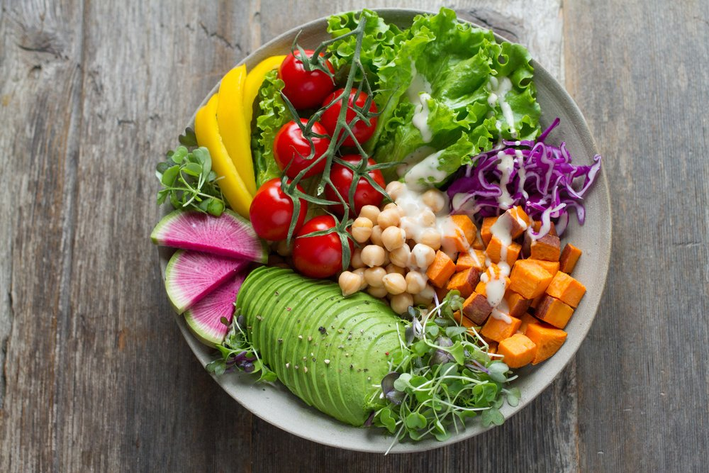 A salad with avocado, chickpeas and tomatoes