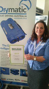 Lorelle McCulloch holding the Innovation Award Certificate for best Equipment at AUSCLEAN.