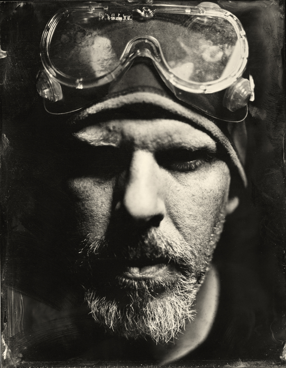 About me - In 2014 I began to explore wet-plate collodion photography. I saw in this mid-nineteenth century process an opportunity to reconnect with photography in a tactile and physical way. I had lost this connection when I left the darkroom for the sterile, hyper-perfect digital world where authenticity is so often stripped away through countless edits and filters.Using fine, rare lenses dating back to the 1850's mounted to simple, box and bellows type cameras, images are created one image at a time by hand using light and chemistry. Every image is a one-of-a-kind original. No wrinkles are removed, no skies are darkened. Perfect imperfection.Along with my passion for wet-plate photography, I am an active commercial photographer with twenty-five years of experience under my belt. When I'm not working with chemicals and 150 year old lenses and cameras, I am often on the road or in my studio shooting assignments for ad agencies, corporations and freelance designers throughout the region.When I'm not looking through a lens, it's all about the fishing.Douglas Lloyd