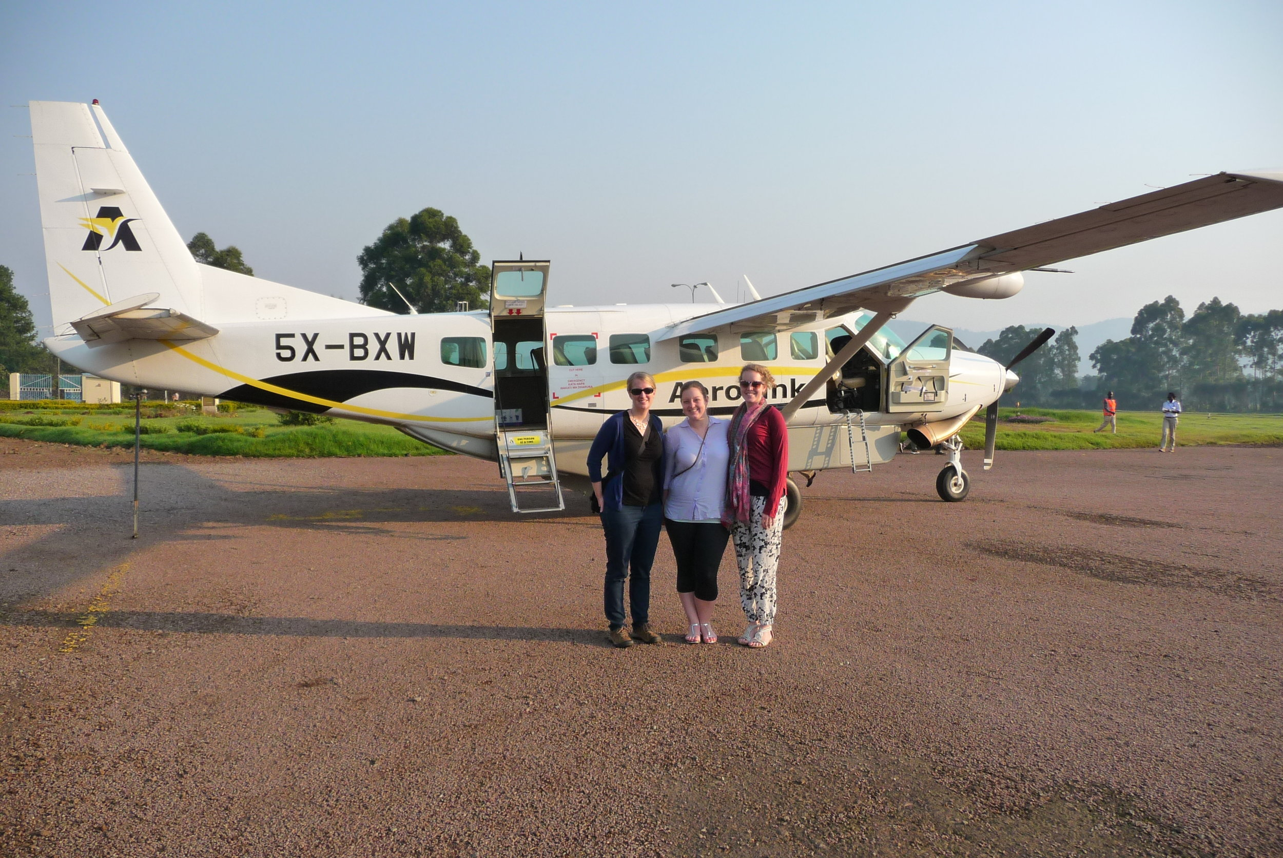 Sheri, Kate and Vivienne in front of a Caravan plane