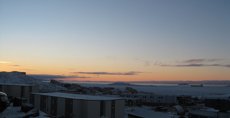 Iqaluit at sunrise with the last sealift boat still in the bay