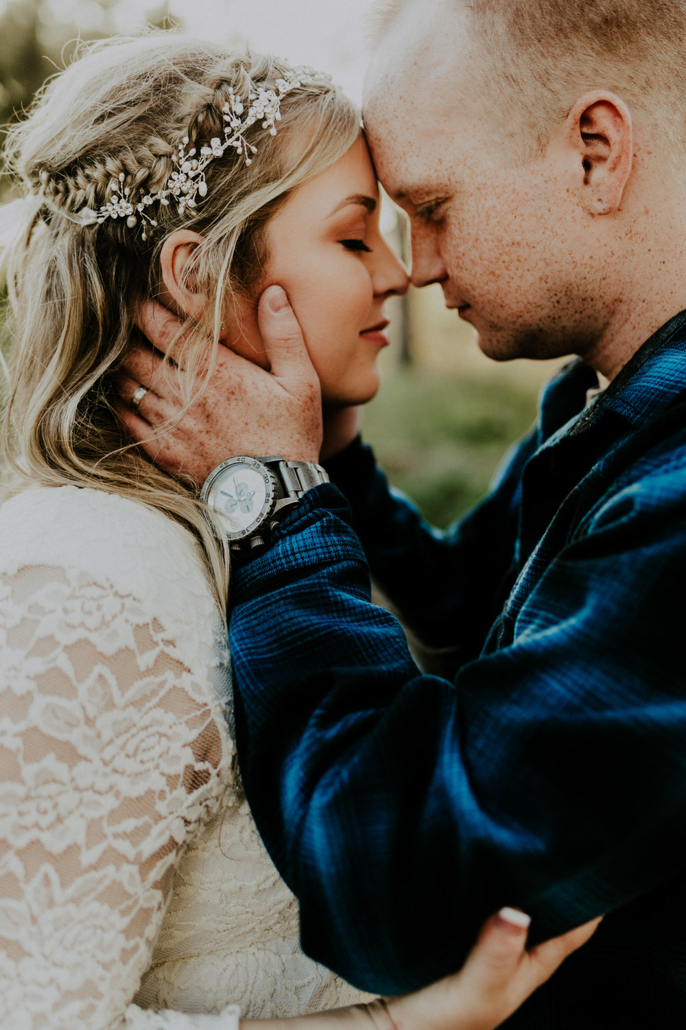 Man kissing his fiance's forehead