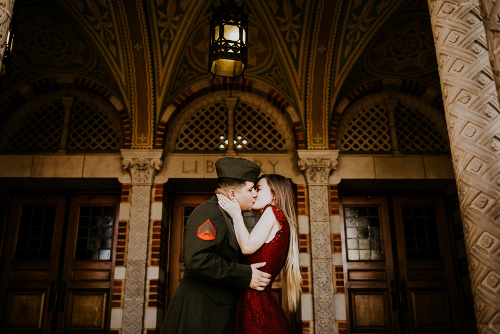 Marine Corporal kissing his fiance in front of building