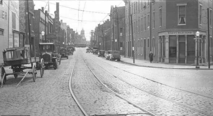 One of the Babies' Milk Fund locations at the corner of McMicken and Race Street in Over-the-Rhine. Courtesy of University of Cincinnati Libraries.