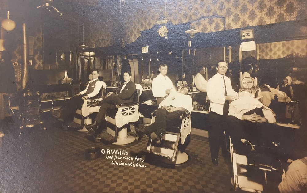 The typical interior of a barbershop in Cincinnati in the early 1900s. Note the Union card hanging on the wall. Courtesy of Blegen Library, University of Cincinnati.
