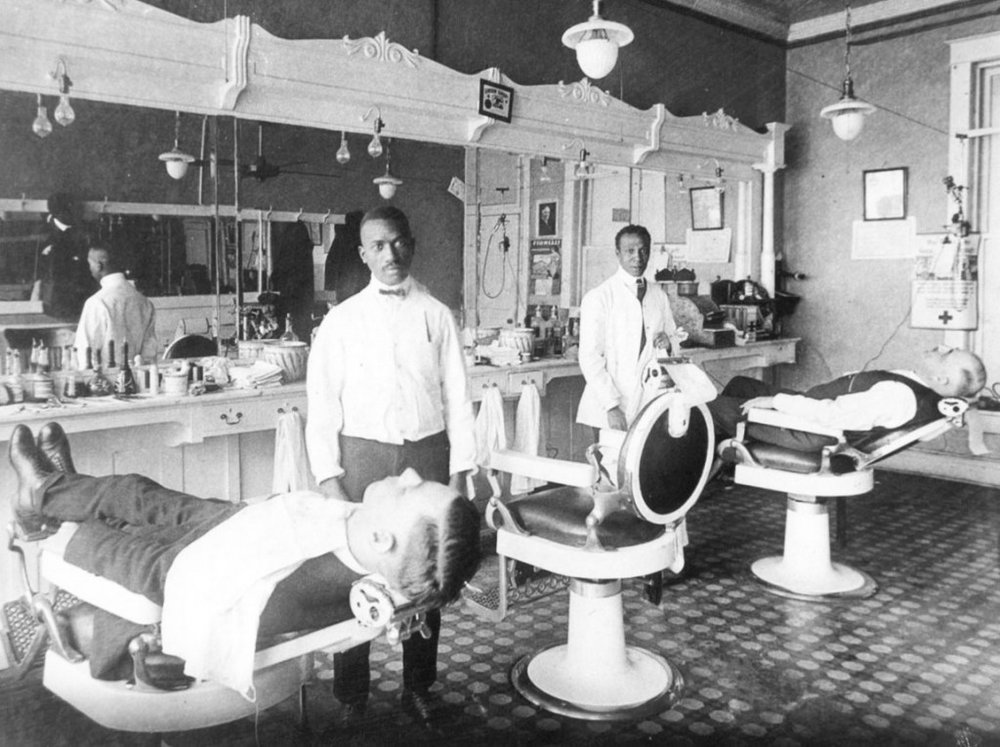 Many Black barbers could only serve white clients due to the color-line in barbering. Courtesy of  Collectors Weekly.