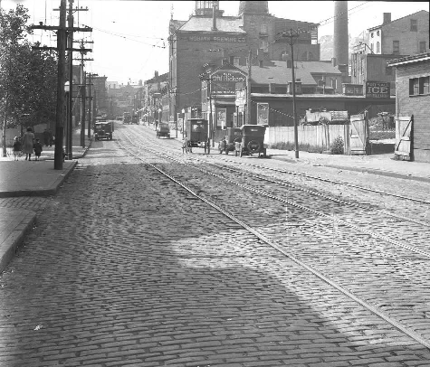 McMicken Ave. streetcar tracks in 1927, right in front of 205-07 W. McMicken. Courtesy of University of Cincinnati Libraries, Digitial Resource Commons.