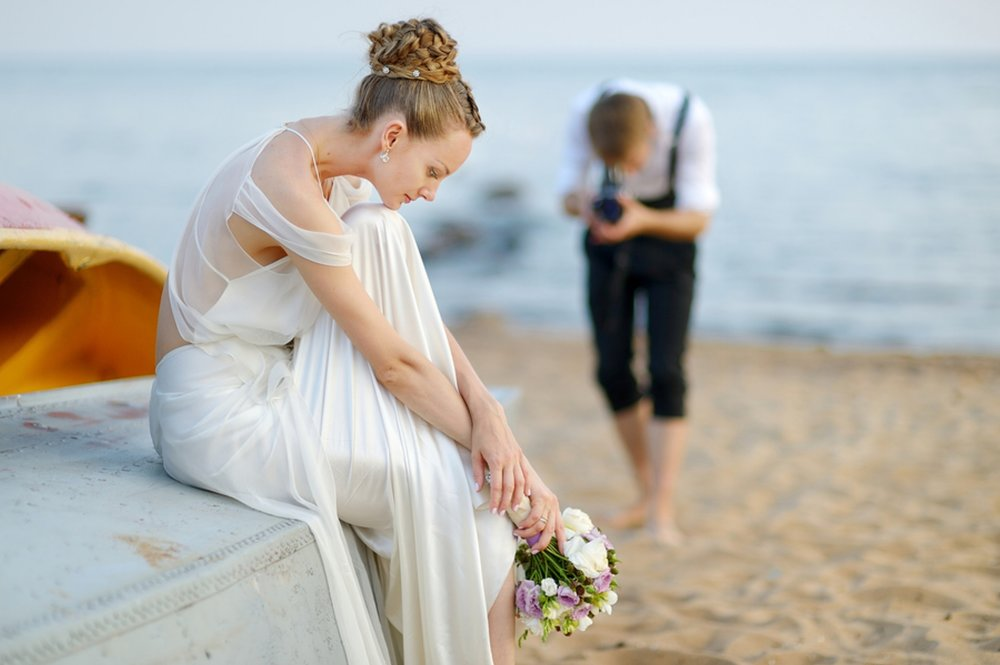 bigstock-Bride-Posing-For-Her-Groom-154122743.jpg