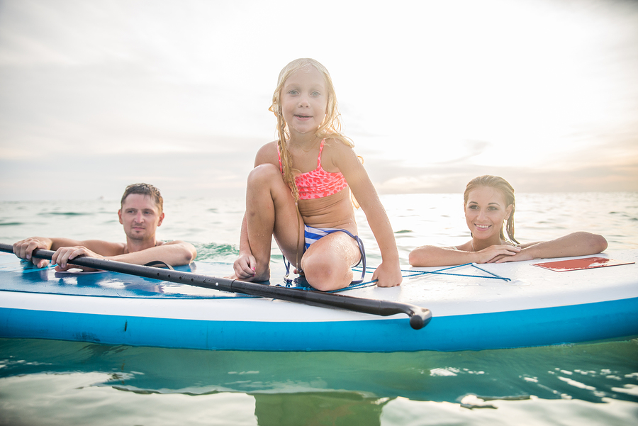 bigstock-Family-With-Paddle-Board-93911435.jpg