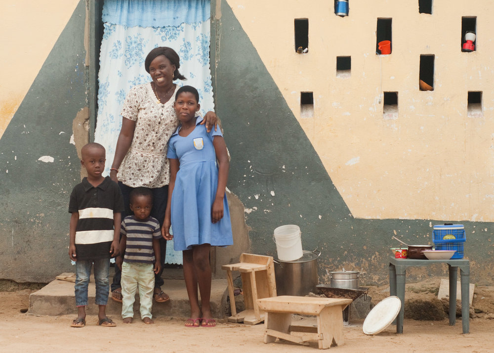 Rebecca and her children outside their home